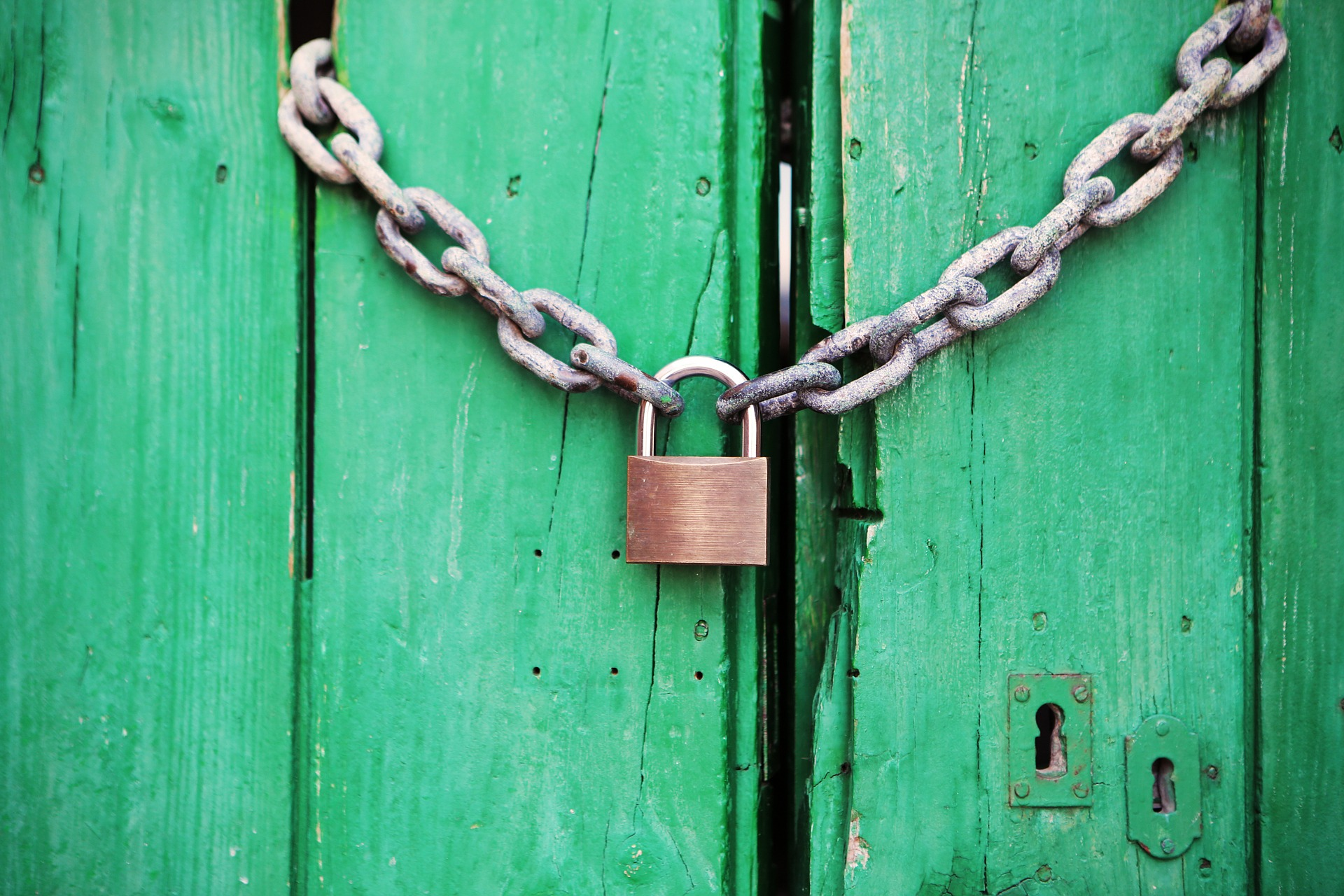 A padlock on a green background